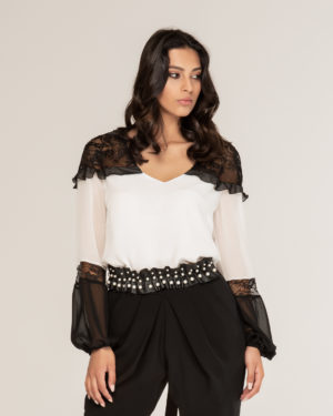 Blusa con spalle in pizzo